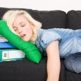 Female student sleeping on sofa