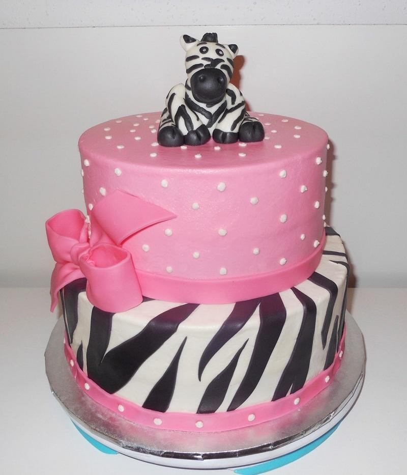 Для детского праздника торт зебру можно сделать двух ярусным и украсить шоколадной фигуркой.